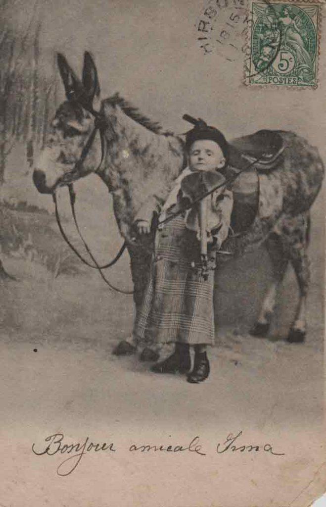 Indexation : Enfant et son âne##Editeur : E.S.W.##Epoque : Ancienne##Date : 1908 (affranchissement)##Propriété : Enf-008-mdv